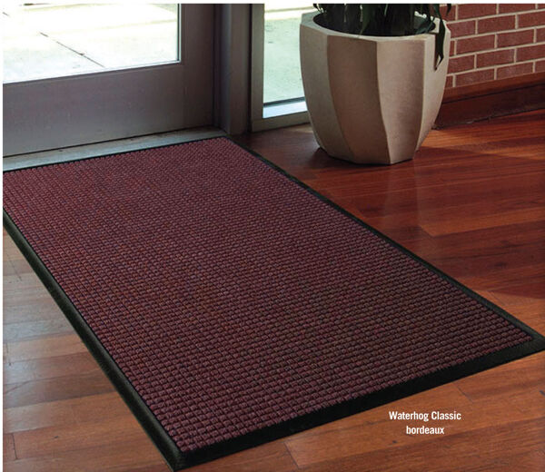 "waterhog classic 6 Floormat.com Perfect for most applications inside or out, Waterhog Classic's unique design makes it revolutionary. The raised rubber ""water dam"" border traps dirt and water, keeping them off carpet and floors. <ul> <li>24 oz.sq/yd solution-dyed polypropylene fabric is highly stain resistant</li> <li>SBR rubber backing contains 20% recycled rubber content</li> <li>3/8"" thick bi-level surface effectively removes and stores dirt and moisture beneath shoe level between cleanings</li> <li>Rubber reinforced face nubs prevent pile from crushing extending performance life of product</li> <li>Unique ""Water Dam"" allows the Waterhog mat to hold up to 1 1/2 gallons of water per square yard, water and dirt stay on the mat</li> <li>Anti-Static</li> <li>Recommended for commercial buildings, hotels, restaurants, healthcare facilities, office buildings and more</li> </ul>"