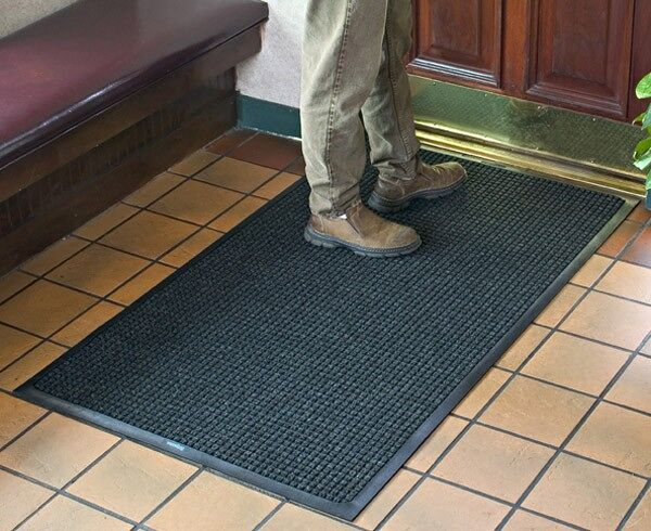 "waterhog classic 8 Floormat.com Perfect for most applications inside or out, Waterhog Classic's unique design makes it revolutionary. The raised rubber ""water dam"" border traps dirt and water, keeping them off carpet and floors. <ul> <li>24 oz.sq/yd solution-dyed polypropylene fabric is highly stain resistant</li> <li>SBR rubber backing contains 20% recycled rubber content</li> <li>3/8"" thick bi-level surface effectively removes and stores dirt and moisture beneath shoe level between cleanings</li> <li>Rubber reinforced face nubs prevent pile from crushing extending performance life of product</li> <li>Unique ""Water Dam"" allows the Waterhog mat to hold up to 1 1/2 gallons of water per square yard, water and dirt stay on the mat</li> <li>Anti-Static</li> <li>Recommended for commercial buildings, hotels, restaurants, healthcare facilities, office buildings and more</li> </ul>"