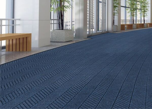 """waterhog echo elite 1 Floormat.com Waterhog mats are constructed with a 100% post consumer recycled P.E.T. polyester fiber system. The herringbone pattern complements Waterhog Eco Elite Roll Goods. <ul> <li>30 oz. sq/yd 100% post consumer recycledPETfabric from plastic bottles</li> <li>3/8"""" thick bi-level surface effectively removes and stores dirt and moisture beneath shoe level between cleanings</li> <li>Unique """"Water Dam"""" allows the Waterhog mat to hold up to 1 1/2 gallons of water per sq yard</li> </ul>"""