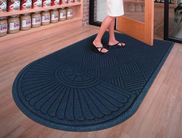 """waterhog eco grand premier 2 Floormat.com Entrance Scraper-Wiper Indoor or Outdoor Matting. The ends that are the rounded end of the mat. Some mats have two rounded ends. The application of the mat will determine which you need. If the mat will be directly against an entry door, you would only need one rounded end and the flat end will go against the door. <ul> <li>Stands up to salt and ice melt</li> <li>TriGrip rubber backing resists slipping, curling and cracking</li> <li>Passes Flammability Standard DOC-FF-1-70</li> </ul> <h2>Eco-friendly & Luxury Carpet Matting</h2> Made of 100% Post-Consumer Recycled PET Polyester reclaimed from plastic drink bottles, this attractive new mat combines years of WaterHog bi-level cleaning technology with the most unique design concept ever! Who said a mat has to look like a """"door mat?"""" Not anymore with these attractive diamond pattern mats! Great for Malls, Banks, Hotels Offices, Restaurants, Healthcare, Supermarkets, and more!<b>Andersen Waterhog Eco Grand Premier Benefits:</b> <ul> <li>Face fabric is heavy 30 oz./sq. yd. 100% Post-Consumer Recycled PET Polyester reclaimed from plastic drink bottles</li> <li>Eight Attractive Colors in Diamond Pattern</li> <li>New Fashion Borders</li> <li>Large Selection of Sizes</li> <li>Smooth or Special Tri-Grip Cleated Back to Minimize Movement; SBR Rubber with 15% post-consumer recycled tires</li> </ul>"""