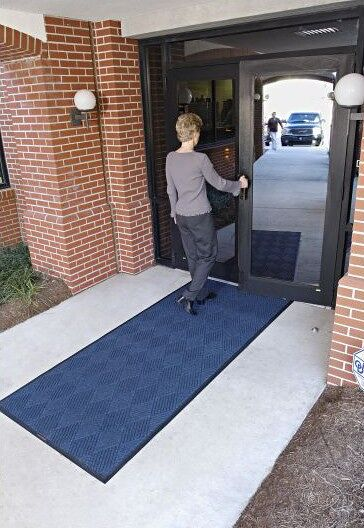 """waterhog eco premier 1 Floormat.com This mat has a beautiful diamond pattern that is as strong as it is durable. Made with 30 oz./sq.yd. polypropylene fabric that is stain resistant. <ul> <li>3/8"""" thick bi-level surface effectively removes and stores dirt and moisture beneath shoe level between cleanings</li> <li>Rubber reinforced face nubs prevent pil from crushing extending performance life of the product</li> <li>Unique """"Water Dam"""" allows the Waterhog mat to hold up to 1 1/2 gallons of water per sq yard, water and dirt stay on mat</li> </ul>"""