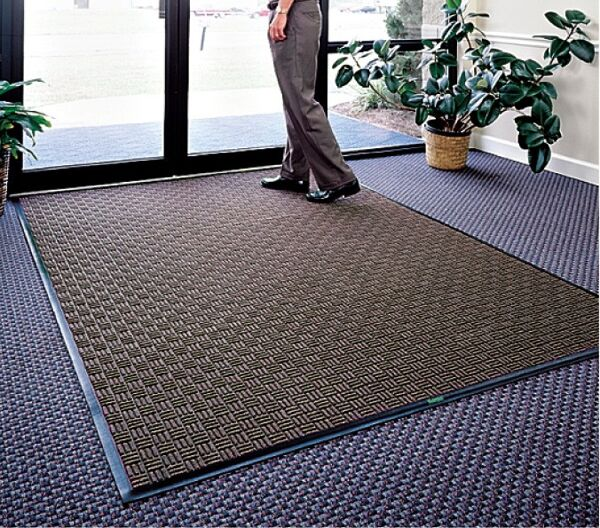 waterhog masterpiece mats 2 Floormat.com Interior scraper-wiper entrance mats for medium traffic areas <ul> <li>28 oz poyproplyene face and a rubber backing with 20% post-consumer recycled tire content</li> <li>Cleated backing (standard) for carpeted floors, optional smooth back for hard floor surfaces and Anchor Safe backing for maximum movement control for problem areas</li> <li>Construction provides a rubber reinforced bi-level surface for long-term service</li> </ul> <h2>Waterhog Masterpiece Select</h2> This entrance mat combines beauty with durability with a unique, parquet pile design. These mats still provide the superior moisture and dirt removal one expects from Waterhog mats. <ul> <li>Innovative parquet design is engineered to scrape dirt and water off feet from all traffic angles and look great doing it</li> <li>Construction provides a rubber reinforced bi-level surface for long-term service</li> <li>28 oz Polypropylene face and a rubber backing with 20% postconsumer recycled tire content</li> <li>Rubber water dam border to keep moisture and dirt from migrating off the mat</li> <li>Cleated backing (standard) for carpet floors or optional smooth back for hard floors</li> <li>Rubber border only (fashion border not available)</li> <li>Not recommended for use in areas exposed to grease or petroleum products</li> <li>Ideal choice for medium traffic placements</li> </ul>
